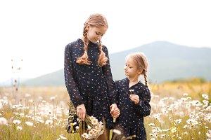 Sisters in meadow