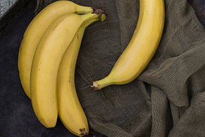 yellow bananas on vintage wooden background