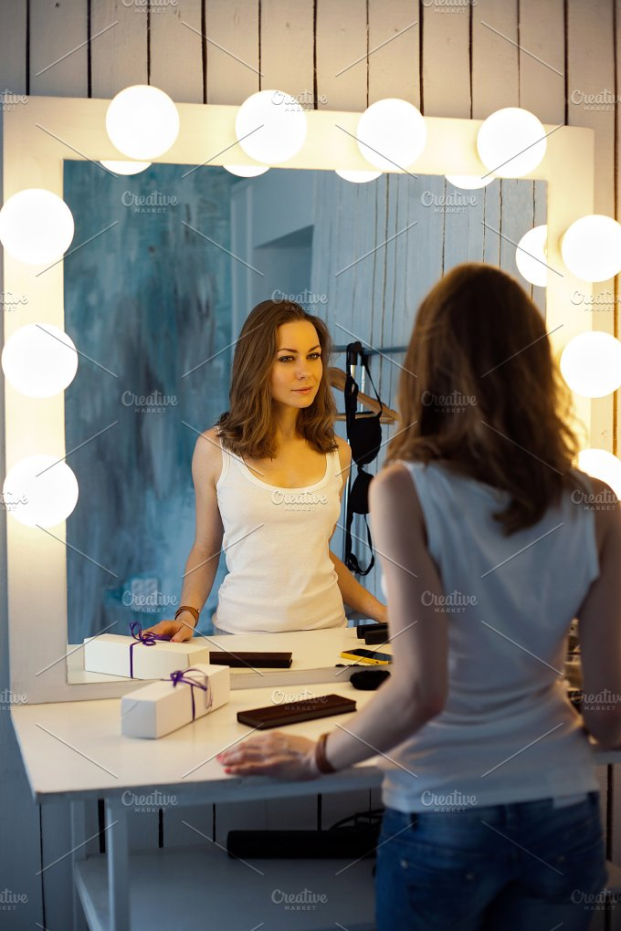 Beautiful girl looking in the mirror people photos on for Looking mirror