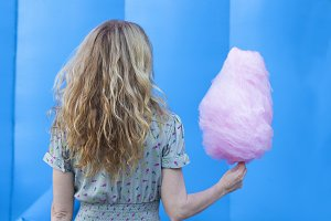 young woman with cotton candy at the party