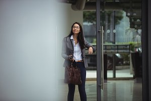 Businesswoman standing at office entrance