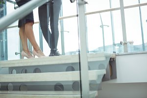 Business executives standing near staircase