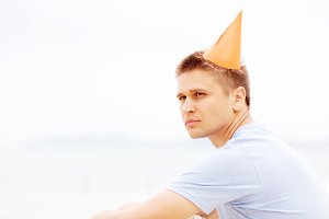 Guy in party hat close-up