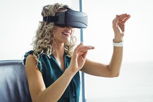 Business executive using virtual reality headset