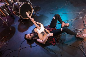 rock and roll girl lying on stage