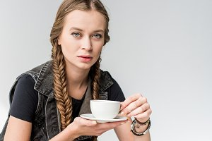blonde woman holding tea cup