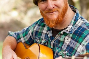 Red haired guy with a guitar