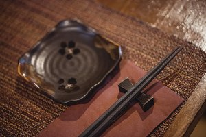 Close-up of chopstick on dining table