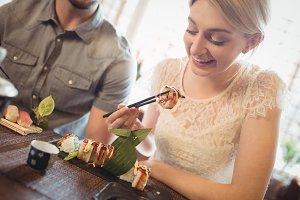 Beautiful woman having sushi
