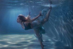 Woman dancing in the underwater.