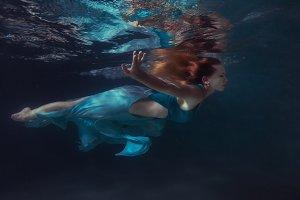 Woman in a dress floats.