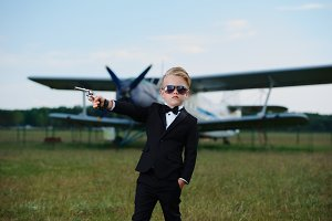 little boy playing secret agent
