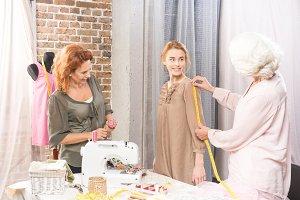 Seamstresses measuring sleeve