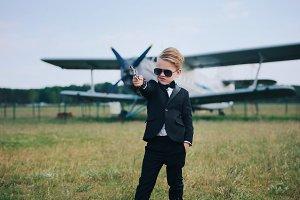 little boy playing secret agent