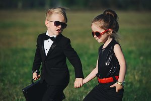 young boy and girl playing spy
