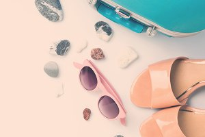 Blue suitcase, coconut, sandals, sun glasses