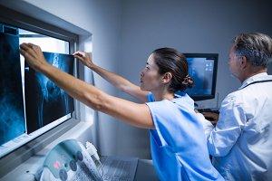 Nurse examining a x-ray