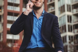 Businessman talking on mobile phone and holding digital tablet
