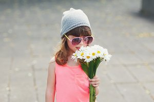 beautiful little hipster girl with flowers
