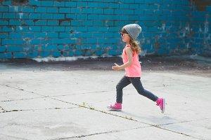 cute little hipster girl running away