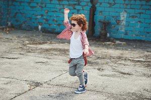 cute little hipster boy running away