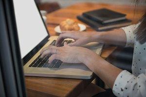 Businesswoman using laptop in café