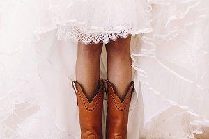 Bride raises her skirt under boots