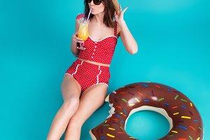Pretty young lady dressed in swimwear wearing sunglasses