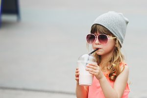 cute little girl with milk cocktail