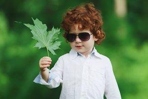 little modern boy on the grass