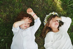 little boy and girl on the grass