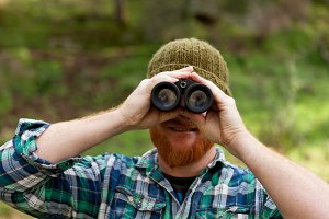 Red haired guy with binoculars