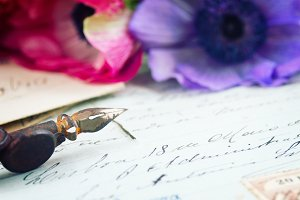 quill pen and antique letter