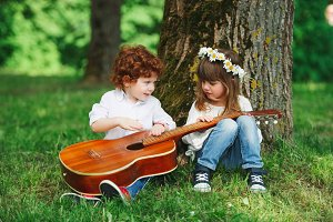 cute little children playing guitar