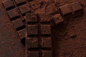 Dark chocolate bar covered in milk chocolate powder