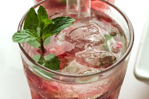 Tasty fresh drinks with berries mint