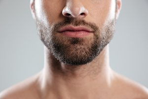 Cropped image of a half mans face with beard