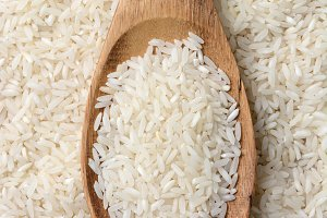 Rice and Wooden Spoon Closeup