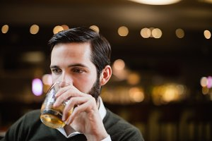 Man having drink in bar