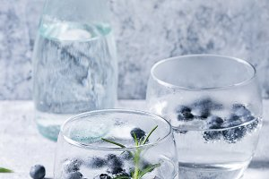 Tonic cocktail with rosemary and blueberries
