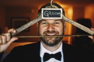 Groom holds a woonder peg