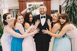 Pretty brides hug a groom