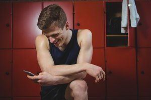 Sportsman using mobile phone