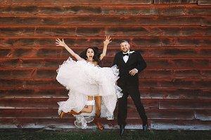 Happy bride's jumping