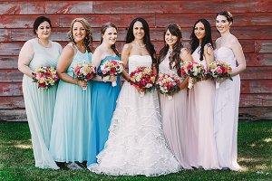 Smiling bridesmaids with bride