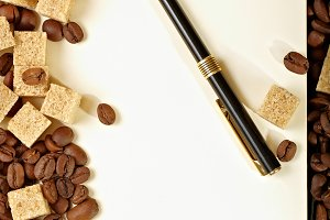 Coffee beans, paper, pen
