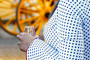 Woman holding glass of fino sherry.