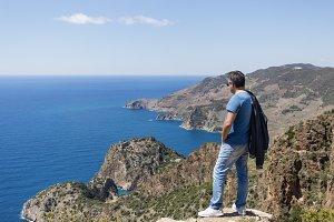 Tourist looking at sea bays in Antiochia ad Cragum