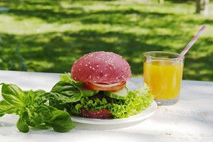 Pink hamburger, basil and juice
