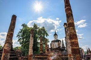 Buddha statue among the ruins
